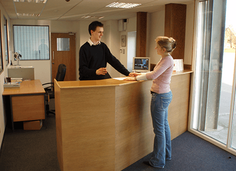 Nuneaton storage unit reception with customer doing paperwork